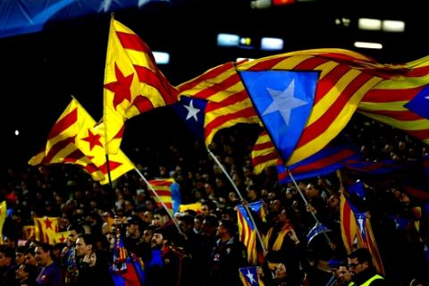 Barcelona fans wave Estelada independence flags during a Champions League quarter-final, first leg soccer match between FC Barcelona and Atletico Madrid at the Camp Nou stadium in Barcelona, Spain, Tuesday April 5, 2016. (AP Photo/Manu Fernandez)