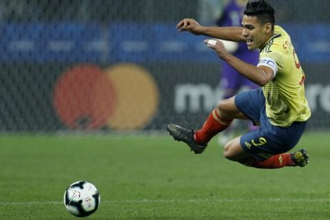 Colombia's Radamel Falcao Garcia falls to the ground during a Copa America quarterfinal soccer match against Chile at the Arena Corinthians in Sao Paulo, Brazil, Friday, June 28, 2019. (AP Photo/Victor R. Caivano)