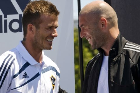 """Los Angeles Galaxy soccer star David Beckham, left, of England, and former French soccer star Zinedine Zidane, right,  help announce the """"Footprint Fields"""" donation program, which will help develop new turf soccer fields in urban location and communities during a news conference, Saturday, July 11, 2009, in El Segundo, Calif. (AP Photo/Gus Ruelas)"""