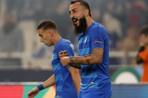 Greece's Kostas Mitroglou, right, celebrates after scoring the opening goal of his team during the UEFA Nations League soccer match between Greece and Hungary at Olympic stadium in Athens, Friday, Oct. 12, 2018. (AP Photo/Thanassis Stavrakis)