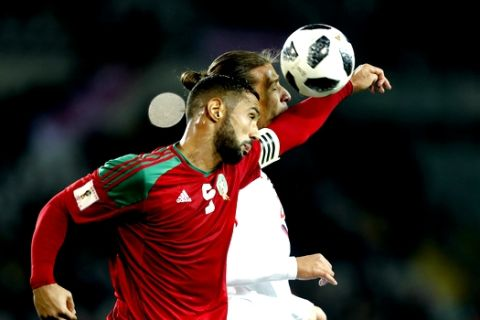Morocco's Medhi Benatia, left, jumps for the ball with Serbia's Aleksander Prijovic during a friendly soccer match between Serbia and Morocco in Turin, Italy, Friday, March 23, 2018. (AP Photo/Antonio Calanni)