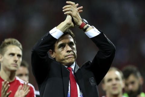 FILE - In this Wednesday, July 6, 2016 file photo, Wales coach Chris Coleman acknowledges the fans at the end of their Euro 2016 semifinal soccer match against Portugal at the Grand Stade in Decines-Charpieu, France. Five straight draws in qualifying for the 2018 World Cup, including one at home to Georgia, left the Welsh fearing theyd be watching the tournament on TV. With no margin for error, Wales has steadied the campaign with wins over Austria and Moldova but Bale and his teammates have a defining week ahead of them: Georgia away on Friday, Oct. 6, 2017 and then a group-ending home match against Ireland on Monday. Realistically, Wales coach Chris Coleman has said, we have to get maximum (points) to give ourselves a chance of second. (AP Photo/Thanassis Stavrakis, file)