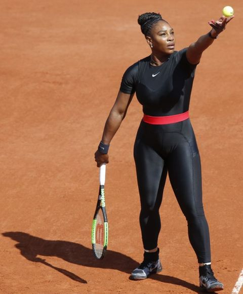 Serena Williams of the U.S. prepares to serve against Karolina Pliskova of the Czech Republic during their first round match of the French Open tennis tournament at the Roland Garros stadium in Paris, France, Tuesday, May 29, 2018. (AP Photo/Michel Euler)