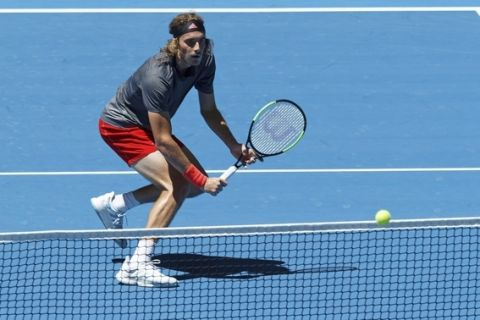Stefanos Tsitsipass of Greece waits for the ball to clear the net during his match against Frances Tiafoe of the United States at the Hopman Cup in Perth, Australia, Monday Dec. 31, 2018. (AP Photo/Trevor Collens)