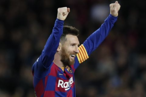 Barcelona's Lionel Messi celebrates after his team scored his side's fourth goal during a Spanish La Liga soccer match between Barcelona and Celta at Camp Nou stadium in Barcelona, Saturday, Nov. 9, 2019. (AP Photo/Joan Monfort)