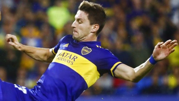Franco Soldano, right, of Argentina's Boca Juniors fights for the ball with Andres Cadavid of Colombia's Independiente Medellin during a Copa Libertadores soccer match at La Bombonera stadium in Buenos Aires, Argentina, Tuesday, March 10, 2020. (AP Photo/Marcos Brindicci)