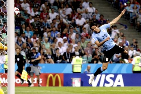 Uruguay's Edinson Cavani scores his side's opening goal during the round of 16 match between Uruguay and Portugal at the 2018 soccer World Cup at the Fisht Stadium in Sochi, Russia, Saturday, June 30, 2018. (AP Photo/Andrew Medichini)