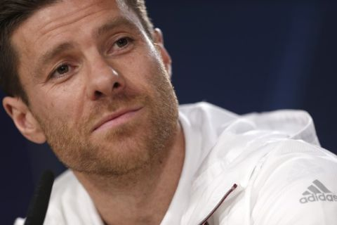 FILE - In this April 17, 2017 file photo, Bayern Munich's Xabi Alonso listens to a question during a news conference at the Santiago Bernabeu stadium in Madrid, Spain. Spanish prosecutors are seeking a five-year prison sentence for former Real Madrid player Xabi Alonso for allegedly defrauding tax authorities of about 2 million euros (2.4 million dollars) from 2010-12. The retired Spain midfielder played for Madrid from 2009-2014. (AP Photo/Francisco Seco, File)