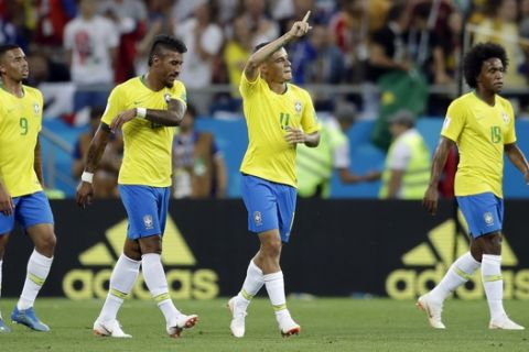 Brazil's Philippe Coutinho, second from right, celebrates after scoring his side's first goal during the group E match between Brazil and Switzerland at the 2018 soccer World Cup in the Rostov Arena in Rostov-on-Don, Russia, Sunday, June 17, 2018. (AP Photo/Felipe Dana)