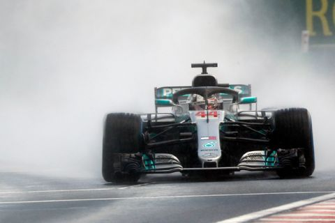 Mercedes driver Lewis Hamilton of Britain steers his car during the qualifying session for the Hungarian Formula One Grand Prix, at the Hungaroring racetrack in Mogyorod, northeast of Budapest, Saturday, July 28, 2018. The Hungarian Grand Prix will be held on Sunday. (AP Photo/Laszlo Balogh)