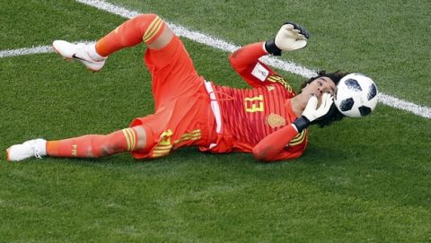 Mexico goalkeeper Guillermo Ochoa makes a save during the group F match between Mexico and Sweden, at the 2018 soccer World Cup in the Yekaterinburg Arena in Yekaterinburg , Russia, Wednesday, June 27, 2018. (AP Photo/Efrem Lukatsky)
