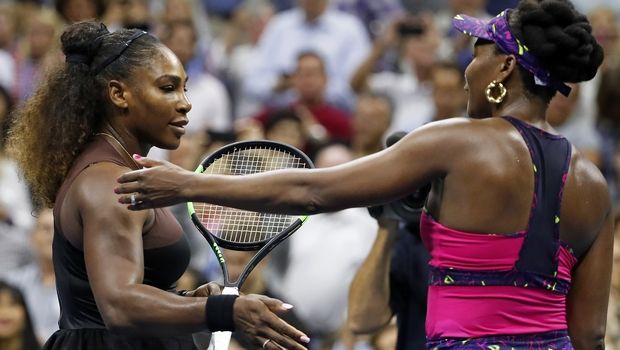 Serena Williams, left, meets her sister Venus Williams after their match during the third round of the U.S. Open tennis tournament, Friday, Aug. 31, 2018, in New York. Serena Williams won 6-1, 6-2. (AP Photo/Adam Hunger)