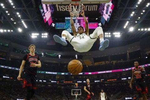 Milwaukee Bucks' Giannis Antetokounmpo dunks during the first half of an NBA basketball game against the Chicago Bulls Thursday, Nov. 14, 2019, in Milwaukee. (AP Photo/Morry Gash)