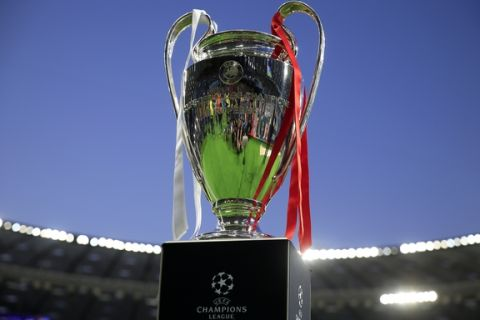 The trophy is displayed on the field before the Champions League Final soccer match between Real Madrid and Liverpool at the Olimpiyskiy Stadium in Kiev, Ukraine, Saturday, May 26, 2018. (AP Photo/Pavel Golovkin)