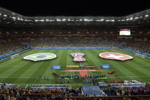Brazil and Switzerland stand for their national anthems ahead of their group E match at the 2018 soccer World Cup in the Rostov Arena in Rostov-on-Don, Russia, Sunday, June 17, 2018. (AP Photo/Andrew Medichini)