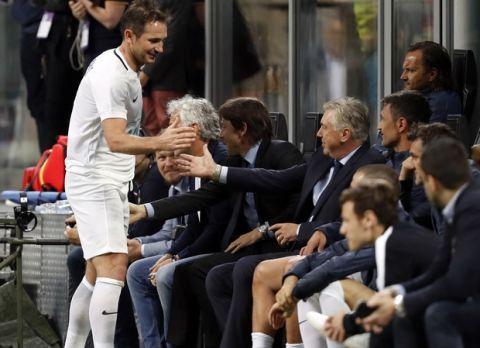 Frank Lampard greets Carlo Ancelotti and Antonio Conte during Andrea Pirlo farewell exhibition match, at the Milan San Siro Stadium, Italy, Monday, May 21, 2018. (AP Photo/Antonio Calanni)