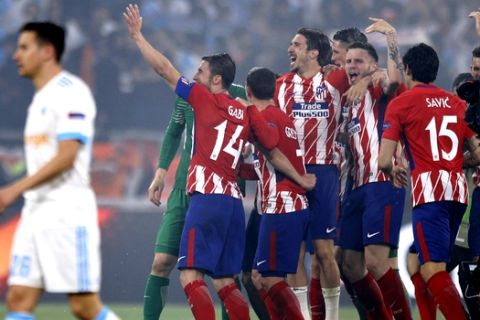Atletico players celebrate after winning the Europa League Final soccer match between Marseille and Atletico Madrid at the Stade de Lyon in Decines, outside Lyon, France, Wednesday, May 16, 2018. (AP Photo/Francois Mori)
