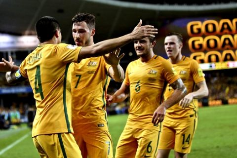 Australia's Tim Cahill, left, celebrates with teammates after scoring a goal against Jordan during their 2018 FIFA World Cup qualifier in Sydney, Australia, Tuesday, March 29, 2016.(AP Photo/Rob Griffith)
