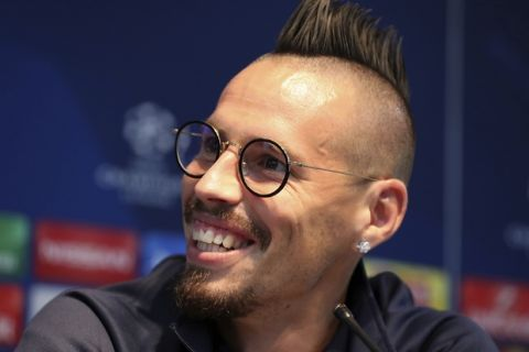 Napoli's Marek Hamsik, smiles during a press conference at the Etihad Stadium, Manchester, England, Monday Oct. 16, 2017. Napoli will play Manchester City in a Champions League match Tuesday. (Martin Rickett/PA via AP)