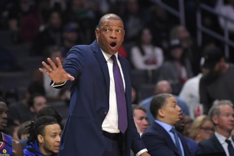 Los Angeles Clippers head coach Doc Rivers gestures during the first half of an NBA basketball game against the Philadelphia 76ers Sunday, March 1, 2020, in Los Angeles. (AP Photo/Mark J. Terrill)