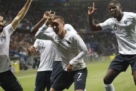 France's Antoine Griezmann, 2nd right, celebrates after scoring his side's 2nd goal with teammates : Paul Pogba, right, Corentin Tolisso and Edil Rami, left, during a friendly soccer match between France and Italy at the Allianz Riviera stadium in Nice, southern France, Friday, June 1, 2018. (AP Photo/Claude Paris)