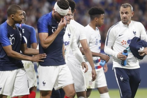 France's Olivier Giroud injured during a friendly soccer match between France and USA at the Groupama stadium in Decines, near Lyon, central France, Saturday, June 9, 2018. (AP Photo/Laurent Cipriani)