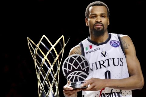 Virtus Bologna's Kevin Punter poses for the media with his trophy as the best player of the tournament next to the Champions League trophy after his team defeated Iberostar Tenerife in the Champions League Final Four final match at the Sportpaleis arena in Antwerp, Belgium, Sunday, May 5, 2019. Virtus Bologna won 73-61. (AP Photo/Olivier Matthys)