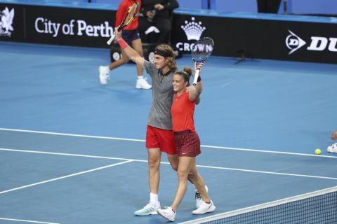 Stefanos Tsitsipass and Maria Sakkari of Greece celebrate winning their mixed doubles match against Serena Williams and Frances Tiafoe of the United States at the Hopman Cup in Perth, Australia, Monday, Dec. 31, 2018. (AP Photo/Trevor Collens)