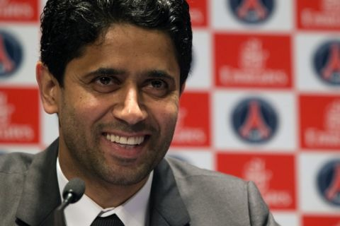 Paris Saint-Germain soccer club President Nasser Al-Khelaifi, speaks to the media during a press conference at Parc des Princes stadium in Paris, Friday, May 17, 2013. Nasser Al-Khelaifi said he wants David Beckham to carry on working with the club after his retirement and is hopeful of reaching an agreement with Beckham within the next two weeks. (AP Photo/Michel Euler)