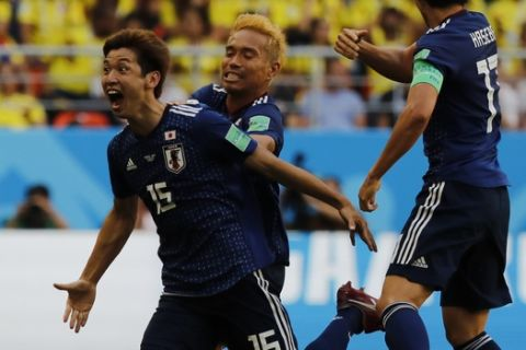 Japan's Yuya Osako celebrates scoring his side's second goal during the group H match against Colombia at the 2018 soccer World Cup in the Mordavia Arena in Saransk, Russia, Tuesday, June 19, 2018. (AP Photo/Eugene Hoshiko)