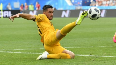 Australia's Joshua Risdon goes for a ball as Peru's Edison Flores, right looks on during the group C match between Australia and Peru, at the 2018 soccer World Cup in the Fisht Stadium in Sochi, Russia, Tuesday, June 26, 2018. (AP Photo/Martin Meissner)