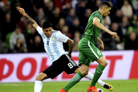 Argentina's Enzo Perez, left, challenges for the ball with Nigeria's William Troost-Ekong during the international friendly soccer match between Argentina and Nigeria in Krasnodar, Russia, Tuesday, Nov. 14, 2017. (AP Photo/Sergey Pivovarov)