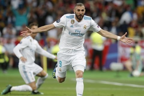Real Madrid's Karim Benzema reacts after being offside during the Champions League Final soccer match between Real Madrid and Liverpool at the Olimpiyskiy Stadium in Kiev, Ukraine, Saturday, May 26, 2018. (AP Photo/Efrem Lukatsky)
