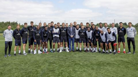 Britain's Prince William, centre, poses for a photo for with the England soccer team during his visit to the FA training ground to meet players ahead of their friendly match against Costa Rica, in Leeds, England, Thursday, June 7, 2018. (Charlotte Graham/Pool Photo via AP)