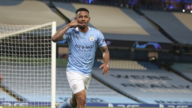 Manchester City's Gabriel Jesus gestures as he celebrates after scoring during the Champions League round of 16, second leg soccer match between Manchester City and Real Madrid at the Etihad Stadium in Manchester, England, Friday, Aug. 7, 2020. (Nick Potts/Pool Photo via AP)
