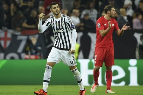 Juventus' forward from Spain Alvaro Morata (L) celebrates after scoring during the UEFA Champions League football match Juventus vs FC Sevilla on September 30 at the Juventus stadium in Turin.  AFP PHOTO / OLIVIER MORIN        (Photo credit should read OLIVIER MORIN/AFP/Getty Images)