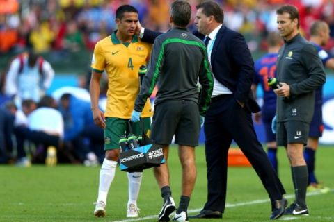 PORTO ALEGRE, BRAZIL - JUNE 18:  Tim Cahill of Australia speaks with coach Ange Postecoglou of Australia (2nd R) during the 2014 FIFA World Cup Brazil Group B match between Australia and Netherlands at Estadio Beira-Rio on June 18, 2014 in Porto Alegre, Brazil.  (Photo by Ryan Pierse - FIFA/FIFA via Getty Images)