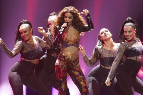Eleni Foureira from Cyprus performs the song 'Fuego' in Lisbon, Portugal, Friday, May 11, 2018 during a dress rehearsal for the Eurovision Song Contest. The Eurovision Song Contest grand final takes place in Lisbon on Saturday May 12, 2018. (AP Photo/Armando Franca)