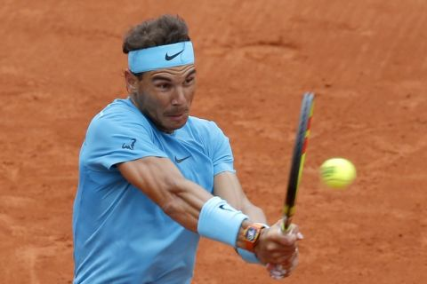 Spain's Rafael Nadal returns a shot against Italy's Simone Bolelli during their first round match of the French Open tennis tournament at the Roland Garros stadium in Paris, France, Tuesday, May 29, 2018. (AP Photo/Michel Euler)