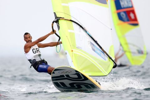 FUJISAWA, JAPAN - JULY 26: Byron Kokkalanis of Greece rounds a mark in the Mens Windsurfer RSX on day three of the Tokyo 2020 Olympic Games at Enoshima Yacht Harbour on July 26, 2021 in Fujisawa, Kanagawa, Japan. (Photo by Phil Walter/Getty Images)