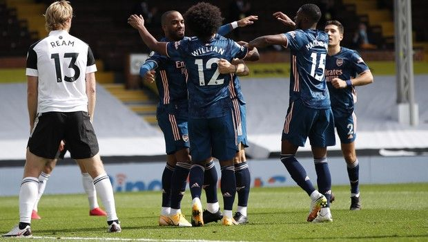 Arsenal's Alexandre Lacazette, second from left, celebrates with teammates after scoring during the English Premier League soccer match between Fulham and Arsenal in London, Saturday, Sept. 12, 2020. (Paul Childs/Pool via AP)
