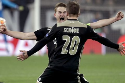 Ajax's Matthijs de Ligt and Lasse Schone celebrate at the end of the Champions League, quarterfinal, second leg soccer match between Juventus and Ajax, at the Allianz stadium in Turin, Italy, Tuesday, April 16, 2019. Ajax won 2-1 and advances to the semifinal on a 3-2 aggregate. (AP Photo/Luca Bruno)