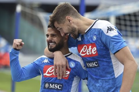Napoli's Lorenzo Insigne celebrates with teammate Fernando Llorente, right, after scoring his side's second goal during an Italian Cup eightfinal soccer match between Napoli and Perugia, at the San Paolo stadium in Naples, Italy, Tuesday, Jan. 14, 2020. (Cafaro/LaPresse via AP)
