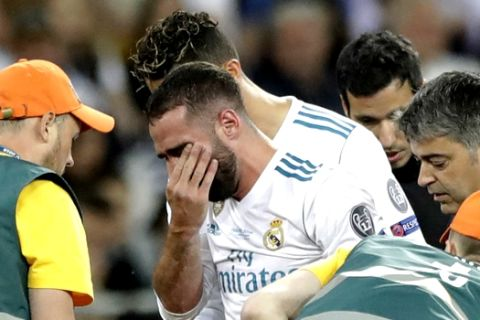 Real Madrid's Daniel Carvajal reacts as he leaves the pitch after being injured during the Champions League Final soccer match between Real Madrid and Liverpool at the Olimpiyskiy Stadium in Kiev, Ukraine, Saturday, May 26, 2018. (AP Photo/Matthias Schrader)