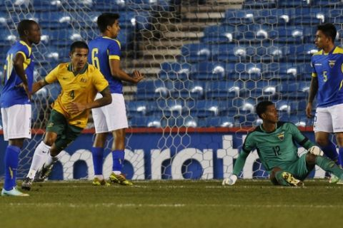 Australia's Tim Cahil, second left, runs to celebrate his goal against Ecuador during a friendly soccer match in London, Wednesday, March 5, 2014. Equador won the match 4-3. (AP Photo/Lefteris Pitarakis)