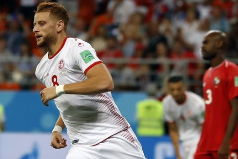 Tunisia's Fakhreddine Ben Youssef celebrates after scoring his side's first goal during the group G match between Panama and Tunisia at the 2018 soccer World Cup at the Mordovia Arena in Saransk, Russia, Thursday, June 28, 2018. (AP Photo/Darko Bandic)