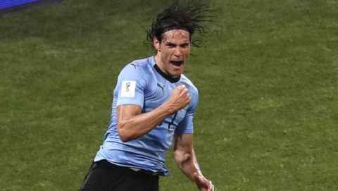 Uruguay's Edinson Cavani celebrates after scoring his side's second goal during the round of 16 match between Uruguay and Portugal at the 2018 soccer World Cup at the Fisht Stadium in Sochi, Russia, Saturday, June 30, 2018. (AP Photo/Darko Vojinovic)