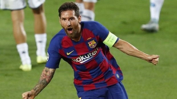 Barcelona's Lionel Messi celebrates after scoring his side's second goal during the Champions League round of 16, second leg soccer match between Barcelona and Napoli at the Camp Nou Stadium in Barcelona, Spain, Saturday, Aug. 8, 2020. (AP Photo/Joan Monfort)
