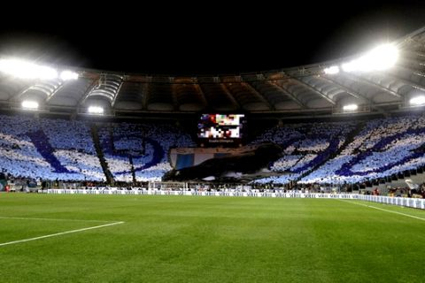 A view of Lazio fans choreography prior to the start of an Italian Serie A soccer match between AS Roma and Lazio, at the Olympic stadium in Rome, Sunday, April 15, 2018. (AP Photo/Gregorio Borgia)