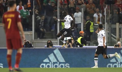 Liverpool's Sadio Mane, center, celebrates after scoring the opening goal during the Champions League semifinal second leg soccer match between Roma and Liverpool at the Olympic Stadium in Rome, Wednesday, May 2, 2018. (AP Photo/Alessandra Tarantino)